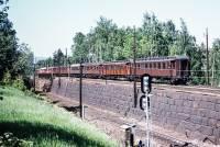 https://pix.njk.no/211//s211425-Hovedbanen-togmedtrevogner-Bryn-1971_2560u-fotoEWJohansson.jpg