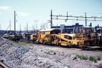 https://pix.njk.no/211/s211452-Hovedbanen-pakkmaskin-Alnabru-1971_2560-fotoEWJohansson.jpg
